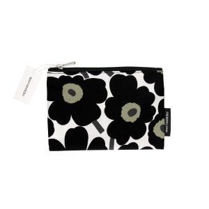 Marimekko Beauty Mini Unikko / Keijuli cosmetic bag Mini unikko cosmetic bags 043444 030 Bustina porta-trucchi realizzata interamente in cotone e decorata con fantasia Unikko in nero con chiusura con zip ed interni foderati.
